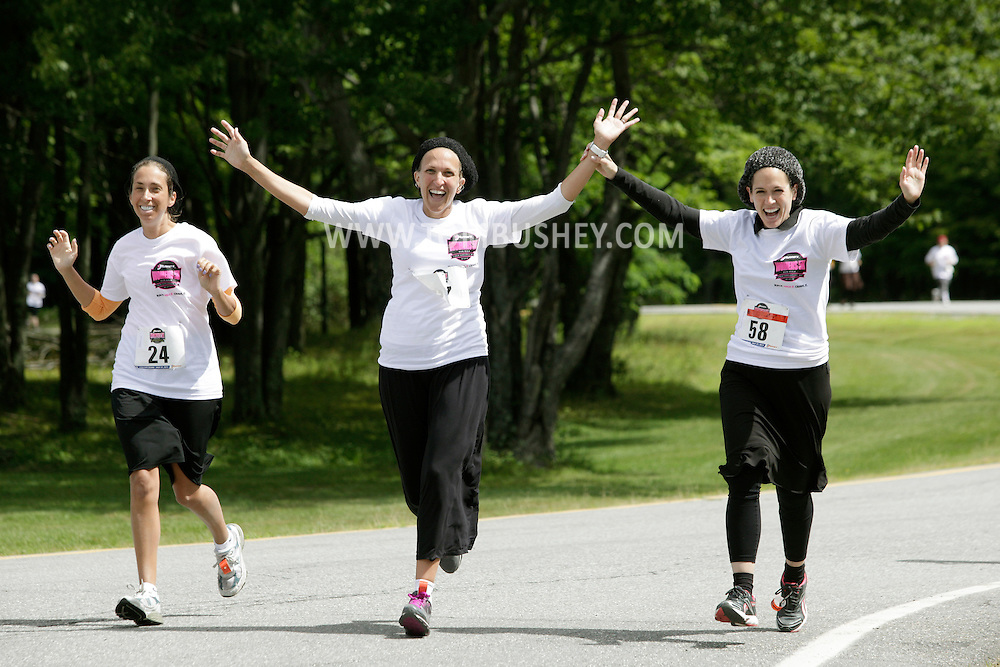 Dasi Gobioff, left, Chaya Kleiner, center, and Bimi Waldner run around the Sullivan County Community College  campus during the Jrunners 5K Run Walk for Women in Loch Sheldrake on Wednesday, July 27, 2011. Many competitors in the race were Orthodox Jewish residents living at summer homes or bungalows in Sullivan County.