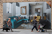 Londoners walk past a marketing billboard for The Levers - a new apartment development on the Walworth Road at Elephant And castle, on 4th September 2018, in Southwark, London, England. The Levers (A Peabody development) will be a complex of 1,2,and 3 bed flats close to Elephant & Castle and Elephant Park - both undergoing major redevelopment.