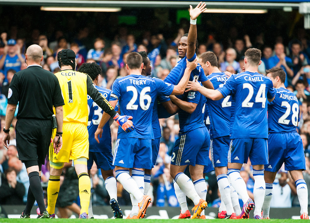 Didier Drogba waves goodbye to the West Stand after he is injured and carried from the pitch during the Barclays Premier League match at Stamford Bridge, London<br /> Picture by Jack Megaw/Focus Images Ltd +44 7481 764811<br /> 24/05/2015