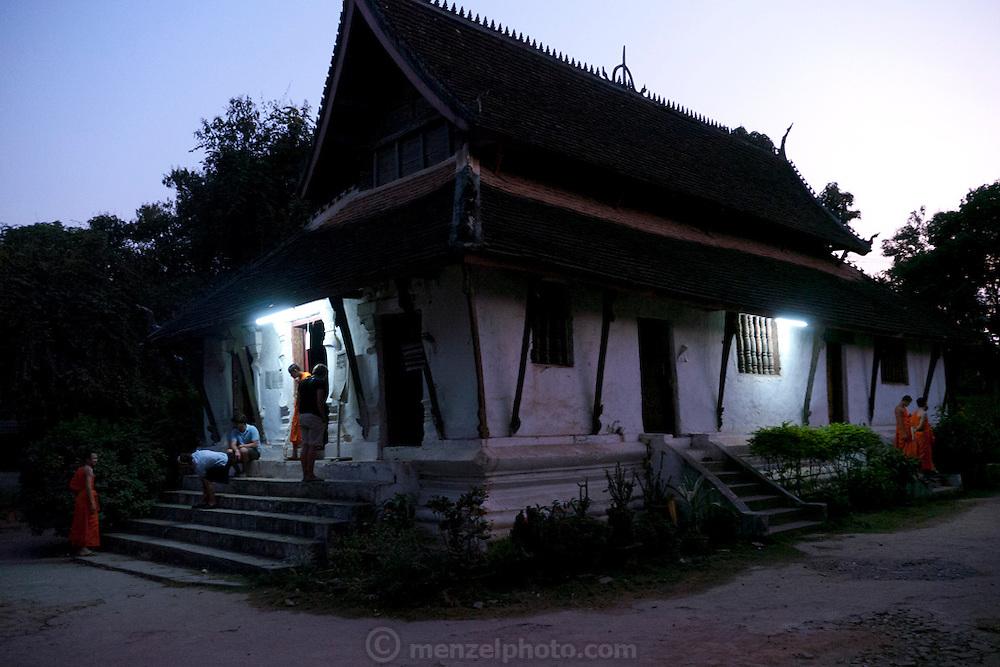 Evening prayers chanted at Wat Pak Khan, Luang Prabang, Laos.