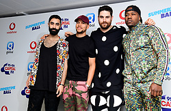 Left to right, Amir Amor, Kesi Dryden, Piers Agget and DJ Locksmith of Rudimental on the red carpet of the media run at Capital's Summertime Ball with Vodafone at Wembley Stadium, London.