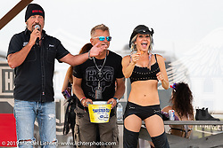 Jesse James Dupree, lead vocalist of Jackyl (and part of the Full Throttle Saloon and Jesse James Bourbon) got on stage to sign a giveaway guitar and announce the winner at the HOG (Harley Owners Group) party by the pool at the Full Throttle Saloon during the Sturgis Black Hills Motorcycle Rally. SD, USA. Thursday, August 8, 2019. Photography ©2019 Michael Lichter.