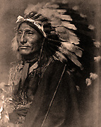 Portrait of Native American man in robe  and feather headdress,1902.  Photograph by Gertrude Käsebier (1852-1934).