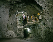 The Derinkuyu underground city is an ancient multi-level underground city extending to a depth of approximately 60 metres, 200 ft. It is large enough to have sheltered as many as 20,000 people together with their livestock and food stores. It is the largest excavated underground city in Turkey and is one of several underground complexes found throughout Cappadocia.