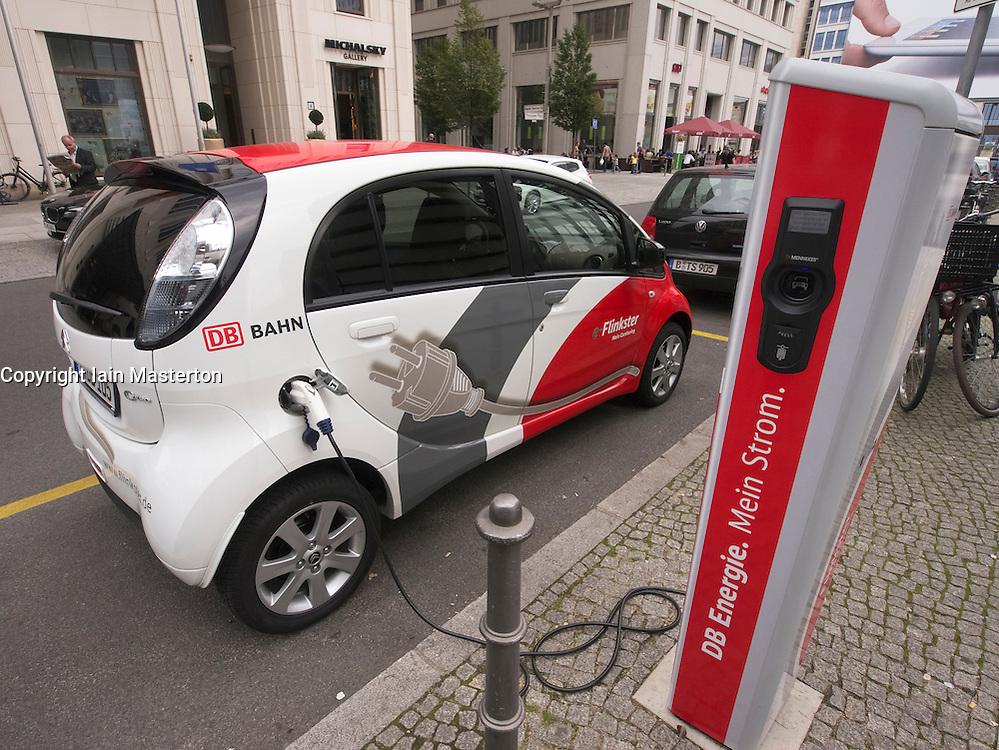 Flinkster DB carsharing electric  car being recharged on street in Berlin German