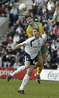Photo: Aidan Ellis.<br /> Preston North End v Norwich City. Coca Cola Championship. 08/04/2006.<br /> Norwich's Jason Shackell beats Preston's David Hibbert to the ball