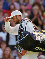 Tennis - 1998 Wimbledon Championships - Mens  Singles - Andre Aggassi v Tommy Haas - Second round<br /> 25/06/1998<br /> <br /> Andre Agassi after defeat to Tommy Haas on Centre court <br /> <br /> Credit : Colorsport / Steve Bardens