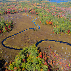 Fall foliage and the Northwest River near Tiger Hill in Sebago, Maine.