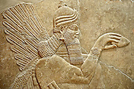 Chaldean Assyrian relief sculpture slab from the northwest palace of King Ashurnasirpal II of a Genie standing. 881-859 B.C form Nimrud or Nimrut ( Kalhu or Kalah). Istanbul Archaeological exhibit Inv. No. 5. .<br /> <br /> If you prefer to buy from our ALAMY PHOTO LIBRARY  Collection visit : https://www.alamy.com/portfolio/paul-williams-funkystock/ancient-assyria-antiquities.html  Type -    Istanbul    - into the LOWER SEARCH WITHIN GALLERY box to refine search by adding background colour, place, museum etc<br /> <br /> Visit our ANCIENT WORLD PHOTO COLLECTIONS for more photos to download or buy as wall art prints https://funkystock.photoshelter.com/gallery-collection/Ancient-World-Art-Antiquities-Historic-Sites-Pictures-Images-of/C00006u26yqSkDOM