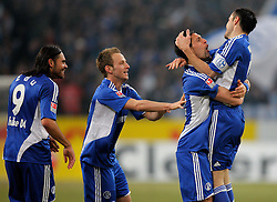 12.03.2010, Veltins Arena, Gelsenkirchen, GER, 1.FBL, Schalke 04 vs VfB Stuttgart, 26. Spieltag, im Bild   Torschütze Kevin Kuranyi (Schalke - GER/BRA #22) jubelt mit Heiko Westermann (Schalke - GER #2) auf dem Arm. In der Mitte ist Ivan Rakitic (Schalke - CRO/SUI #10) und links Edu (Schalke - #28) EXPA Pictures © 2010, PhotoCredit: EXPA/ nph/  Scholz