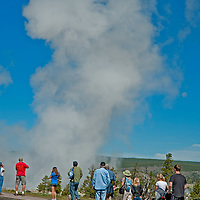 Tourists admire Fountain Geyser erupting at Lower Geyser Basin in Wyoming's Yellowstone National Park.