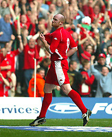 Photo: Scott Heavey<br />Wales V Azerbaijan. 29/03/03.<br />John Hartson celebrates his first and Wales' third during this afternoons Euro 2004 Group 9 qualifying match at the Millenium stadium in Cardiff.