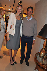 JASON and KATRINE TSADILAS  at a champagne breakfast hosted by Carolina Gonzalez-Bunster and TOD's in aid of the Walkabout Foundation held at TOD's, 2-5 Old Bond Street, London on 9th May 2013.