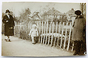 mother walking with little child 1900s England