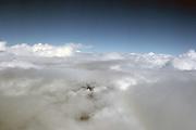 Cumulostratus clouds over mountain peaks