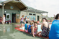 Swimmers enjoy a relaxing afternoon by the water at the Kiwanis Pool in St. Johnsbury Vermont.  Karen Bobotas / for Kiwanis International