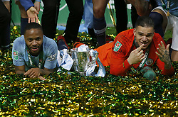 BRITAIN-LONDON-FOOTBALL-CARABAO CUP FINAL-CHELSEA VS MAN London.(190224) -- LONDON, Feb. 24, 2019  Manchester City's Raheem Sterling (L) and goalkeeper Ederson (R) celebrate on the ground with the Carabao Cup after the Carabao Cup Final match between Chelsea and Manchester City at Wembley Stadium in London, Britain on Feb. 24, 2019. Manchester City won 4-3 on penalties after a 0-0 draw.  FOR EDITORIAL USE ONLY. NOT FOR SALE FOR MARKETING OR ADVERTISING CAMPAIGNS. NO USE WITH UNAUTHORIZED AUDIO, VIDEO, DATA, FIXTURE LISTS, CLUB/LEAGUE LOGOS OR ''LIVE'' SERVICES. ONLINE IN-MATCH USE LIMITED TO 45 IMAGES, NO VIDEO EMULATION. NO USE IN BETTING, GAMES OR SINGLE CLUB/LEAGUE/PLAYER PUBLICATIONS. (Credit Image: © Matthew Impey/Xinhua via ZUMA Wire)
