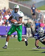 Marshall quarterback Bernard Morris (14) rushes past Kansas State nose tackle Quintin Echols (56) in the first half, at Bill Snyder Family Stadium in Manhattan, Kansas, September 16, 2006.  The Wildcats beat the Thundering Herd 23-7.
