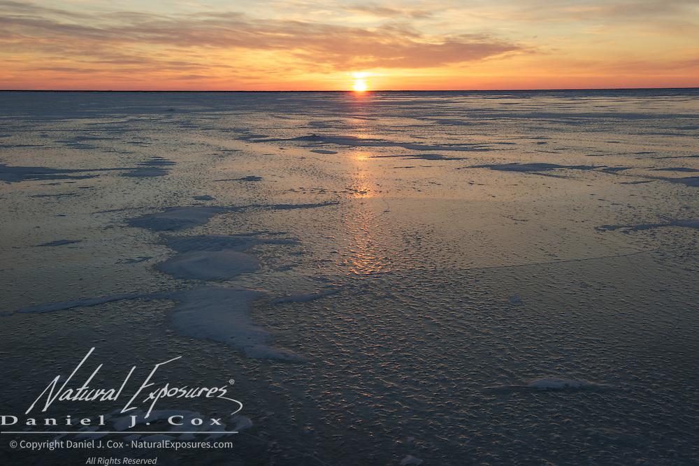 Sun sets over the lake near Cape Churchill, Hudson Bay, Manitoba