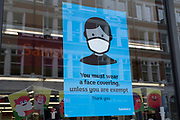 Face mask advice outside Sainsburys supermarket as the national coronavirus lockdown three continues on 5th March 2021 in London, United Kingdom. With the roadmap for coming out of the lockdown has been laid out, this nationwide lockdown continues to advise all citizens to follow the message to stay at home, protect the NHS and save lives, and the streets of the capital are quiet and empty of normal numbers of people.