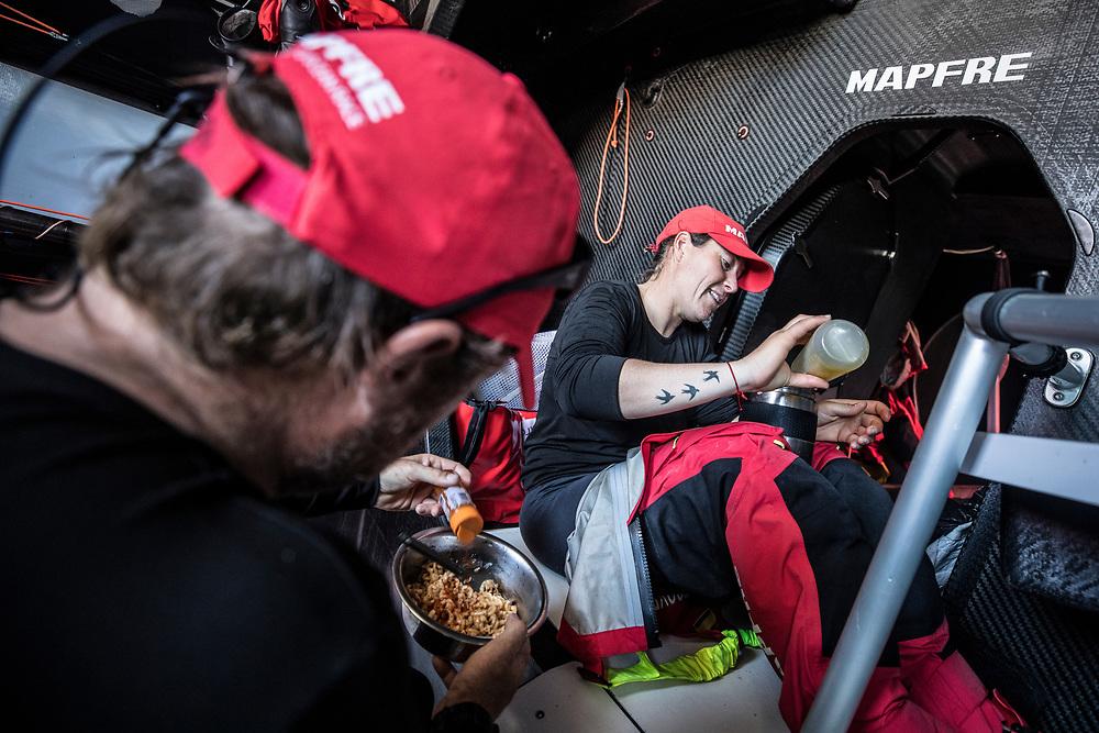 Leg 02, Lisbon to Cape Town, day 13, on board MAPFRE, Tamara Echegoyen and Antonio Cuervas-Mons eating. Photo by Ugo Fonolla/Volvo Ocean Race. 17 November, 2017