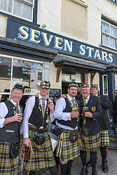 Members of the Falmouth Marine Band take a welcome break for refreshment during the Penryn Festival in Cornwall