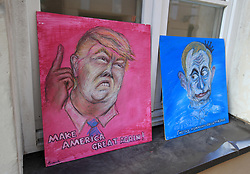 Artwork of Vladimir Putin and Donald Trump for sale during the 2018 FIFA World Cup Qualifying Group F match at the LFF Stadium, Vilnius. PRESS ASSOCIATION Photo. Picture date: Sunday October 8, 2017. See PA story SOCCER Lithuania. Photo credit should read: Mike Egerton/PA Wire. RESTRICTIONS: Use subject to FA restrictions. Editorial use only. Commercial use only with prior written consent of the FA. No editing except cropping.