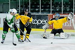 Gregor Rezek of HK Olimpija vs goalie Ziga Antonic of HK Slavija during of ice-hockey match between HK Olimpija and HK Slavija in  SLOHOKEJ league, on September 21, 2011 at Hala Tivoli, Ljubljana, Slovenia. (Photo By Matic Klansek Velej / Sportida)