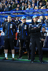 4th November 2017 - Premier League - Huddersfield Town v West Bromwich Albion - Huddersfield manager David Wagner (R) stands alongside assistant Christoph Buhler (C) and goalkeeping coach Paul Clements (L) - Photo: Simon Stacpoole / Offside.
