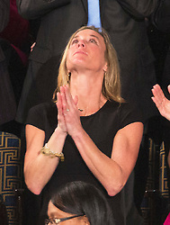 """Carryn Owens (black dress), the widow of William """"Ryan"""" Owens, a Navy SEAL killed in the Trump administration's first counterterrorism operation in Yemen looks skyward while being acknowledged by U.S. President Donald J. Trump during his address to a joint session of Congress on Capitol Hill in Washington, DC, USA, February 28, 2017. Photo by Chris Kleponis/CNP/ABACAPRESS.COM"""