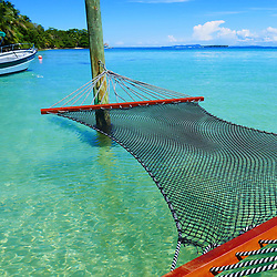 EXCLUSIVE: How about owning your own tropical Caribbean luxury resort for just $10. American couple Suzanne and Dave Smith are selling off their incredible Casa Cayuco Eco Adventure Lodge, in Bocas del Toro, Panama, Central America. But instead of listing their stunning multi-million-pound island getaway for sale they are offering the chance for anyone who buys a $10 ticket to win their extraordinary lifestyle and profitable business. Dave and Suzanne have spent five years turning a former rustic lodge into one that has just been voted number one resort on TripAdvisor in Panama. Their incredible two-acre slice of heaven is bordered by sloth-filled rainforest to the rear and crystal clear coral sea to the front. The lucky winner of the 24-guest resort will become owner of four stand-alone cabins, a main lodge, two lodge suites, and an air-conditioned luxury owner's suite designed by Dave and Suzanne themselves and built by skilled local carpenters. Outside, Casa Cayuco comes with its own jetty and thatch covered sun terrace as well as everything you need to run a business, including commercial kitchen communication tower, laundry and maintenance building and THREE power boats, each over 23-foot long. Kayaks, snorkelling, spear fishing and paddle boards and surf gear are also ready and waiting to be used by a new owner and guests alike. And if that's not enough, British competition organisers WinThis.Life https://winthis.life/index.aspx# are offering a $50,000 cash injection to welcome the new owners. All those wishing to take part have to do is buy one or more tickets and play a spot-the-ball-type competition on the website. Entries are being taken extension until April 11. Dave, 35, and Suzanne, 33, first arrived on the island in 2013 with just seven suitcases having decided to sell up from their home and corporate lives near Detroit, Michigan, USA. 16 Feb 2018 Pictured: Pic shows a hammock for guests at the Caribbean resort Casa Cayuco in Panama which one lucky