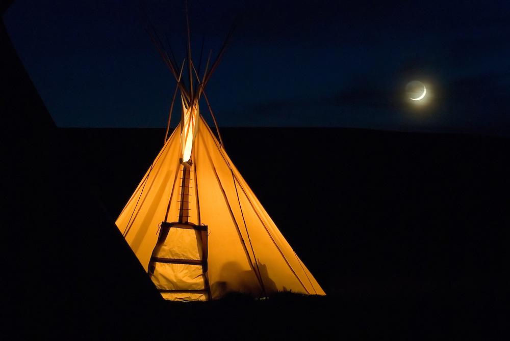 Teepee glowing on a moonlit night on the Zumwalt Prairie in Eastern Oregon.