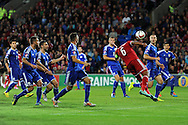 An unmarked Ashley Williams of Wales (6) heads over the crossbar. Euro 2016 qualifying group B match, Wales v Bosnia- Herzegovina at the Cardiff city Stadium in Cardiff, South Wales on Friday 10th Oct 2014.<br /> pic by Andrew Orchard, Andrew Orchard sports photography.