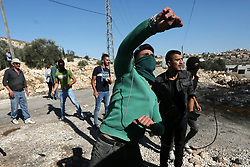November 2, 2018 - Nablus, West Bank - Palestinian protesters hurl stones towards Israeli forces during clashes following a weekly demonstration against the expropriation of Palestinian land by Israel in the village of Kfar Qaddum, near the West Bank city of Nablus. (Credit Image: © Shadi Jarar'Ah/APA Images via ZUMA Wire)