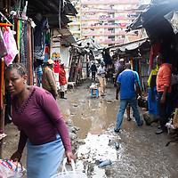 Street scene in Mukuru Kwa Njenga, Nairobi. Slum areas like this suffer from poor drainage and sanitation.