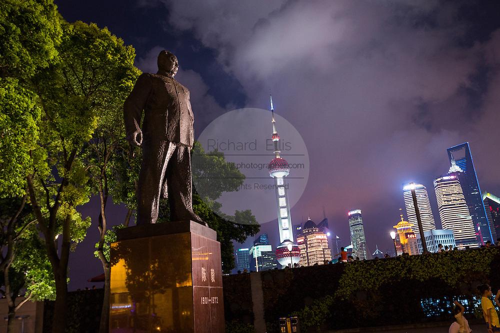 Statue of Shanghai Mayor Chen Yi on the Bund at night in Shanghai, China.