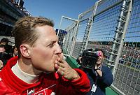 08.03.03 Melbourne , Australia<br />Michael Schumacher , Ferrari celebrates pole position<br />PHOTO TIM PARKER FOTOSPORTS INTERNATIONAL/xpb