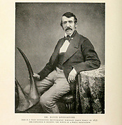 Dr. David Livingstone (Photographed in 1857) The Explorer Is Holding The Horns Of A White Rhinoceros From the Book '  Britain across the seas : Africa : a history and description of the British Empire in Africa ' by Johnston, Harry Hamilton, Sir, 1858-1927 Published in 1910 in London by National Society's Depository