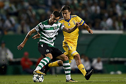 October 31, 2017 - Lisbon, Portugal - Sporting's midfielder Bruno Fernandes (L) vies for the ball with Juventus's forward Paulo Dybala (R)  during Champions League 2017/18 match between Sporting CP vs Juventus FC, in Lisbon, on October 31, 2017. (Credit Image: © Carlos Palma/NurPhoto via ZUMA Press)