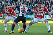 Kyle McAllister of St Mirren gets stopped by the Hamilton pairing of Scott Martin & Scott McMann during the Ladbrokes Scottish Premiership match between St Mirren and Hamilton Academical FC at the Paisley 2021 Stadium, St Mirren, Scotland on 13 May 2019.