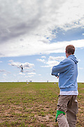 Connor Doran and his stunt kite. Windscape Kite Festival, Swift Current, Saskatchewan.