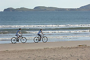 Cycling on Ballinskelligs Beach, Waterville, County Kerry..Picture by Don MacMonagle