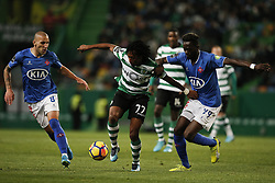 December 1, 2017 - Lisbon, Portugal - Sporting's forward Gelson Martins (C) vies for the ball with Belenenses's midfielder Andre Sousa (L) and Belenenses's midfielder Bouba Sare (R)  during Primeira Liga 2017/18 match between Sporting CP vs CF Belenenses, in Lisbon, on December 1, 2017. (Credit Image: © Carlos Palma/NurPhoto via ZUMA Press)