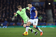 Gareth Barry of Everton shields the ball from Kevin De Bruyne of Manchester City. Capital one cup semi final 1st leg match, Everton v Manchester city at Goodison Park in Liverpool on Wednesday 6th January 2016.<br /> pic by Chris Stading, Andrew Orchard sports photography.