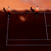 PARIS, FRANCE June 11. Ground staff water the clay court between sets as the early evening shadows creep across Court Philippe-Chatrier during the semi finals of the singles competition at the 2021 French Open Tennis Tournament at Roland Garros on June 11th 2021 in Paris, France. (Photo by Tim Clayton/Corbis via Getty Images)