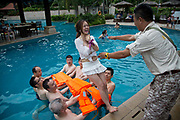 Participants of Diamond Love, a high-end dating service, take part in pool games in Sanya, Hainan Province,  China on15 June  2013.  Male participants of the dating service pay up to 20,000 USD to attend such events in hopes of finding a suitable match while most of the women are selected by the match making service according to their looks, education, and personality.