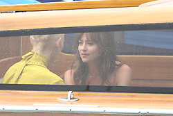 EXCLUSIVE: Dakota Johnson and Tilda Swinton seen in a boat in the rain in Venice. 01 Sep 2018 Pictured: Dakota Johnson, Tilda Swinton. Photo credit: AMA / MEGA TheMegaAgency.com +1 888 505 6342