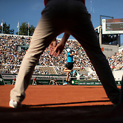 PARIS, FRANCE June 01. Dominic Thiem of Austria returns a serve from Pablo Cuevas of Uruguay as the line judge signals the serve was good during the Men's Singles third round match on Court Suzanne Lenglen at the 2019 French Open Tennis Tournament at Roland Garros on June 1st 2019 in Paris, France. (Photo by Tim Clayton/Corbis via Getty Images)