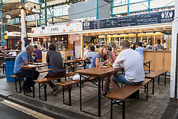 Cafes and restaurants at at indoor market , Markethalle Neun, Kreuzberg, Berlin, Germany.