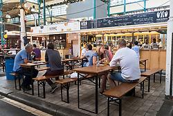 Cafes and restaurants at at indoor market , Markethalle Neun, Kreuzberg, Berlin, Germany.